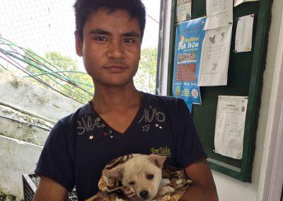 A-man-brings-his-puppy-for-treatment-at-DAS